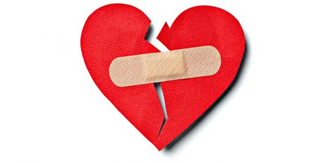 A paper heart held together by a band-aid